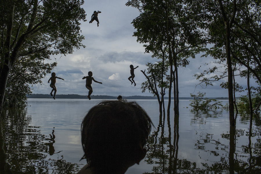 Children play in the Tapajós River, home to the Munduruku people, in the Brazilian Amazon on February 10, 2015. Construction plans threaten to displace the community.
