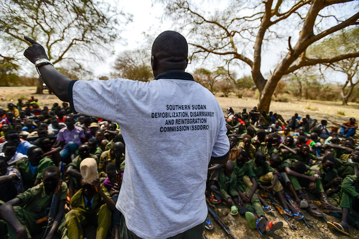 A worker from the South Sudan National Disarmament, Demobilization and Reintegration Commission addresses children undergoing release from an armed group, in Pibor, South Sudan, in February 2015.