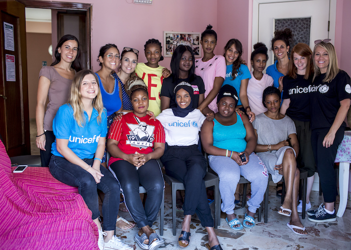 On August 7, 2019, UNICEF Ambassador Halima Aden (in white shirt, center) met with young asylum seekers at a UNICEF-supported reception center in Palermo, Italy.