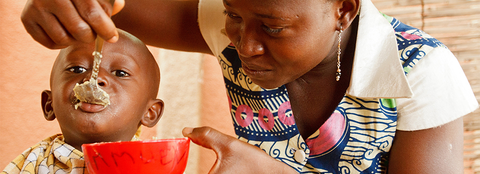 A woman feeds nutritional porridge to her son, in the health centre in Secteur (Sector) 1, a division of Fada N'gourma, the capital of Est Region.