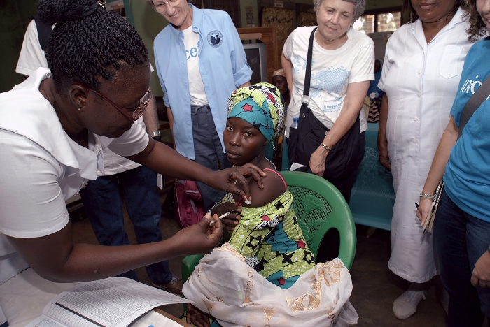 Margaret Pesewu gives expecting mother Hamdia (age 22) her TD vaccine at Savelugu Municipal Hospital