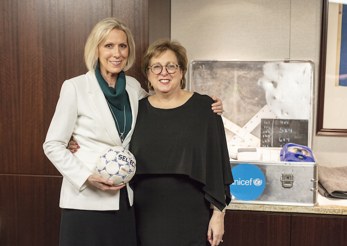 Sister Joy D. Jones, primary general president of The Church of Jesus Christ of Latter-day Saints and Caryl Stern, former president and CEO of UNICEF USA, stand together with a few UNICEF Inspired Gifts displayed in the 2018 Giving Machines.