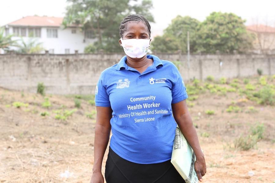 Adama Kamara, a Community Health Worker in Hastings, western Sierra Leone, heads out to do home visits.