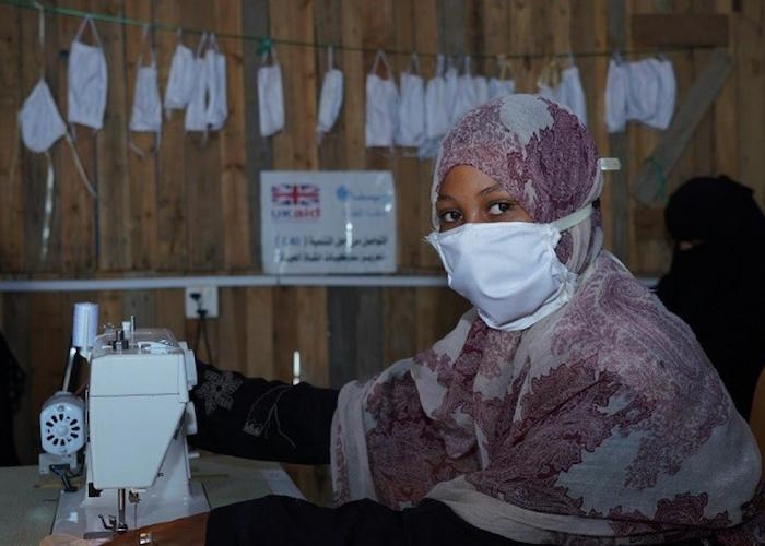 With support from UNICEF, members of a mothers' club at the Al-Shab IDP center in Aden, Yemen are sewing masks to protect their families and their community from the spread of the novel coronavirus.
