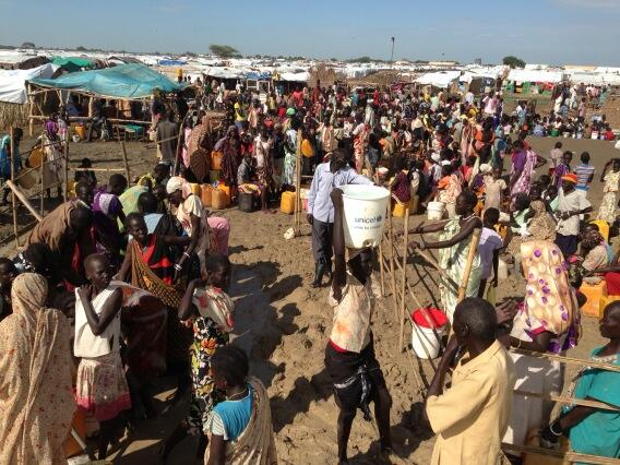 Families gather at a UNICEF water collection point in Bentiu, South Sudan.