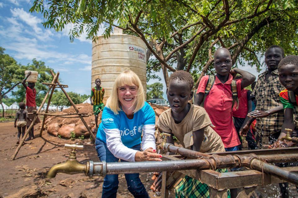 Carol Hamilton, lends a hand at a water point, Kule Camp, Gambella region of Ethiopia. © UNICEF USA