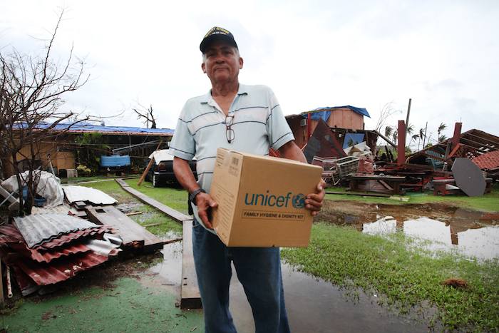 After Hurricane Maria damaged his house and knocked out his power and water supply, Gulf War veteran Rafael Torres received a family hygiene kit from UNICEF.