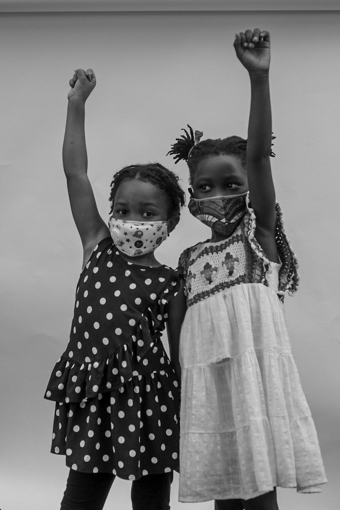 Friends Kennedy (left) and Amina reunited at the Children's March outside the Brooklyn Public Library in June, 2020.