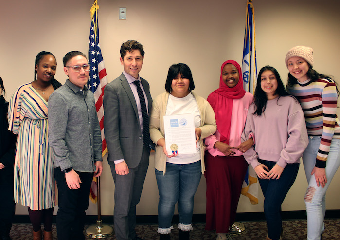 Minneapolis Mayor Jacob Frey (in jacket and tie) and members of the Minneapolis Youth Congress celebrate the launch of CFCI..