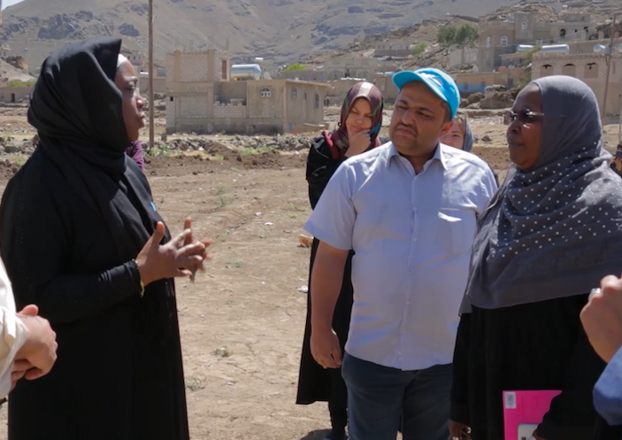 UNICEF Yemen Representative Sara Beysolow Nyanti (in black) visits solar panel network project in Ibb, Yemen.