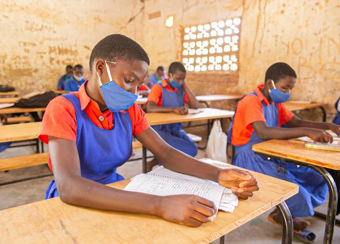 Students at Luwambaza primary school in northern Malawi's Nkhatabay district sit at desks provided by the Kids In Need of Desks Fund.