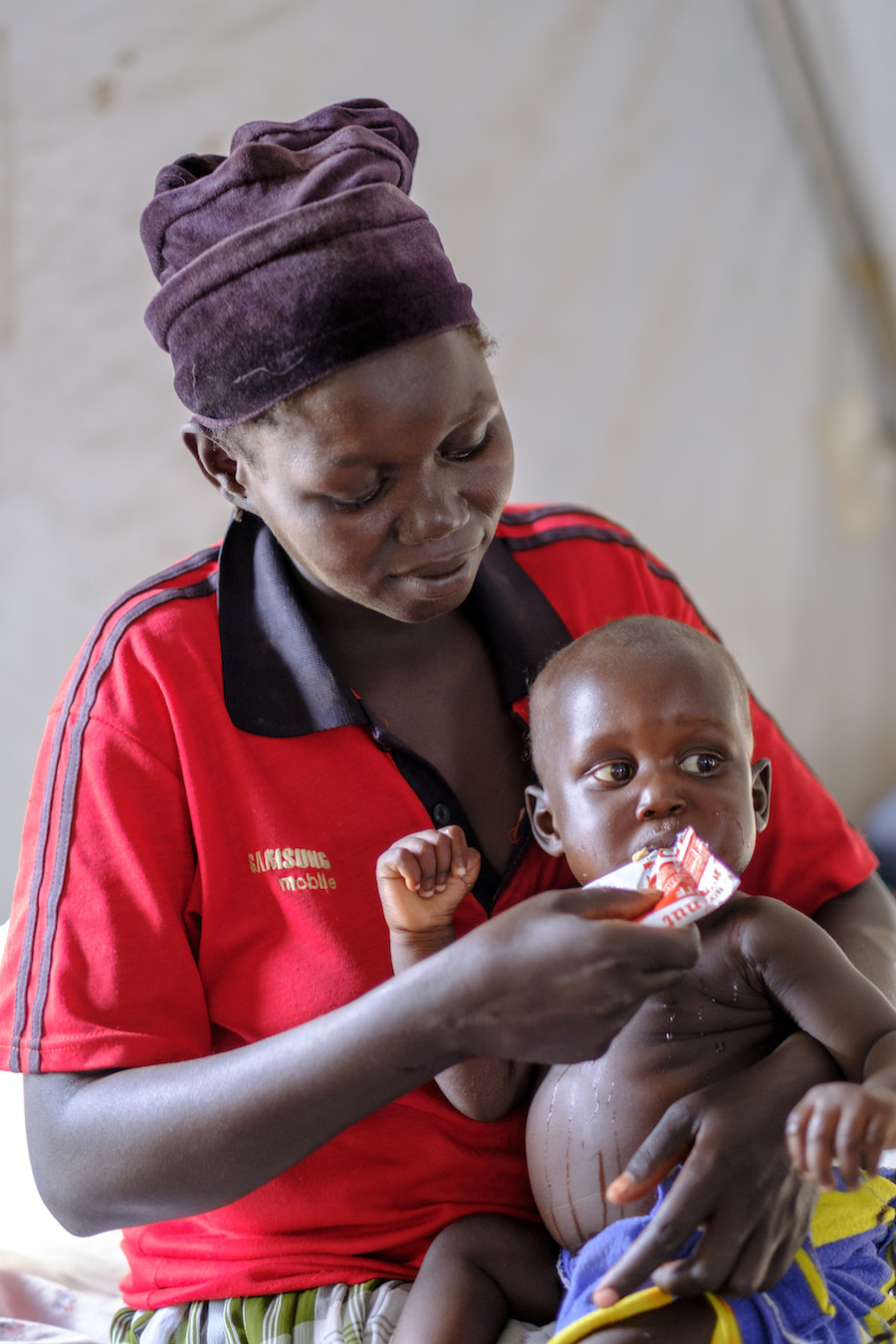 A recently arrived refugee from South Sudan feeds her baby in Bidi Bidi Refugee Settlement in Yumbe district, Uganda.