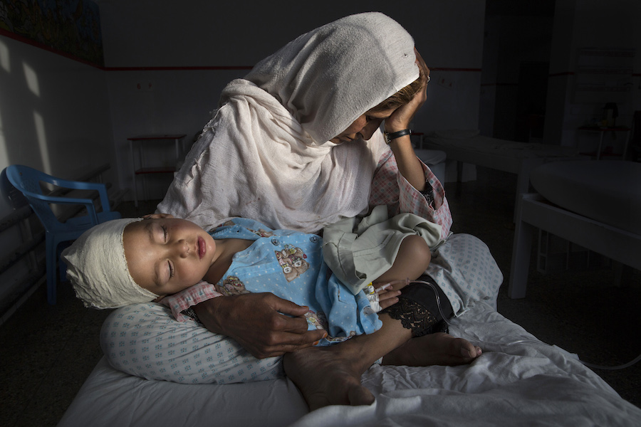 Najiba holds her nephew Shabir, 2, who was injured in a bomb blast that killed his sister, in Kabul, Afghanistan, in March 2019.