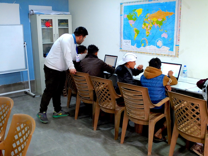 A computer literacy class for young people living in Debaga camp in northern Iraq.