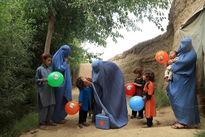 Roving vaccination teams protect children against polio in Nahri Siraj, Helmand, Afghanistan.