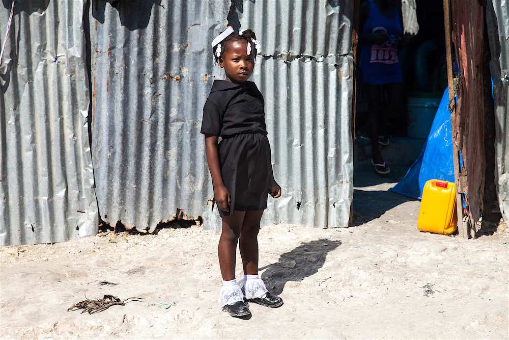 Eight-year-old Haitian girl, Loudina Bien Aimer, orphaned by Hurricane Matthew, on the way to her temporary, UNICEF-supported school in Jérémie.