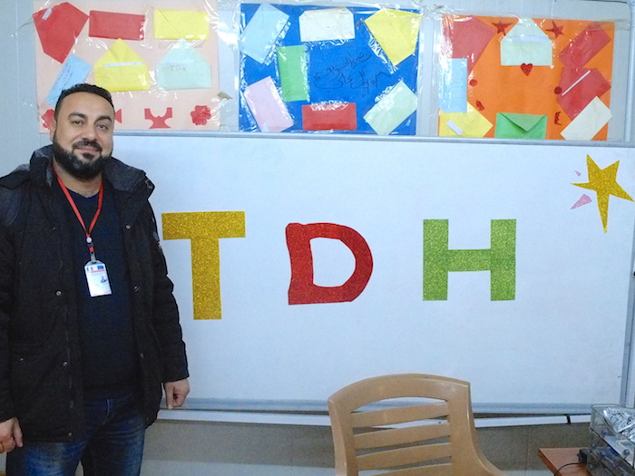 Ayad Hamed, a project manager with UNICEF partner TDH, works with at risk youth in the Debaga camp in northern Iraq.