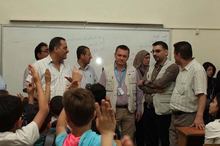 Radoslaw Rzehak, Chief of Field Office, UNICEF Aleppo (center) and other UNICEF staff visit students of Hatem Al Ta'i primary school in Aleppo few hours after an attack killed four children and injured three others on Thursday 14 October 2016.
