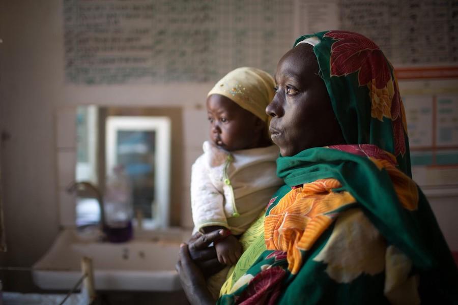 Hawa Mustafa holds her 6-month-old daughter, Muna Ibrahim, at the UNICEF-supported Homosha health center in Ethiopia's remote Benishangul-Gumuz region.