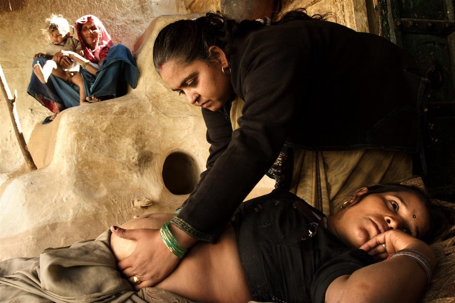 Vinita Kalra, a midwife, performs an antenatal checkup during a home visit in Rajasthan State, India.