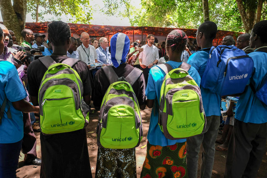 "On April 17, 2018 in Yambio, South Sudan, children released from armed groups receive a ""reintegration pack"" filled with supplies from UNICEF to support their transition back into the community."