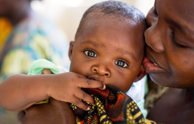 Bertha is living with HIV, but she was able to prevent transmission of HIV to her six-month-old baby, Tecla