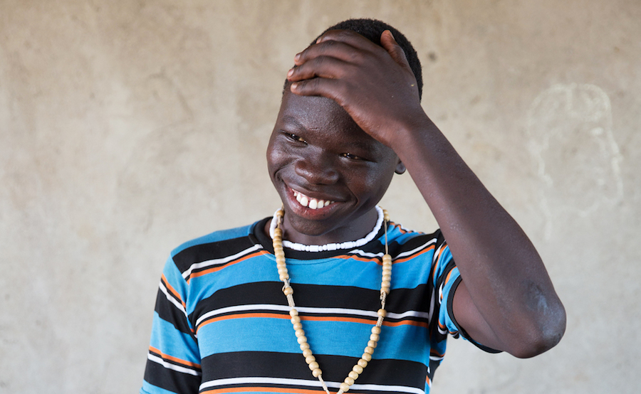Patrick, 16, watched his father being killed in South Sudan. Now he lives in Uganda's Bidi Bidi refugee camp.