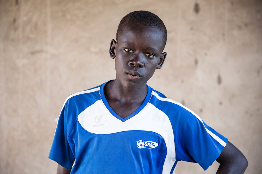 Isaac, 14, lost his parents in South Sudan's civil war. He arrived in Uganda's Bidi Bidi refugee camp alone.