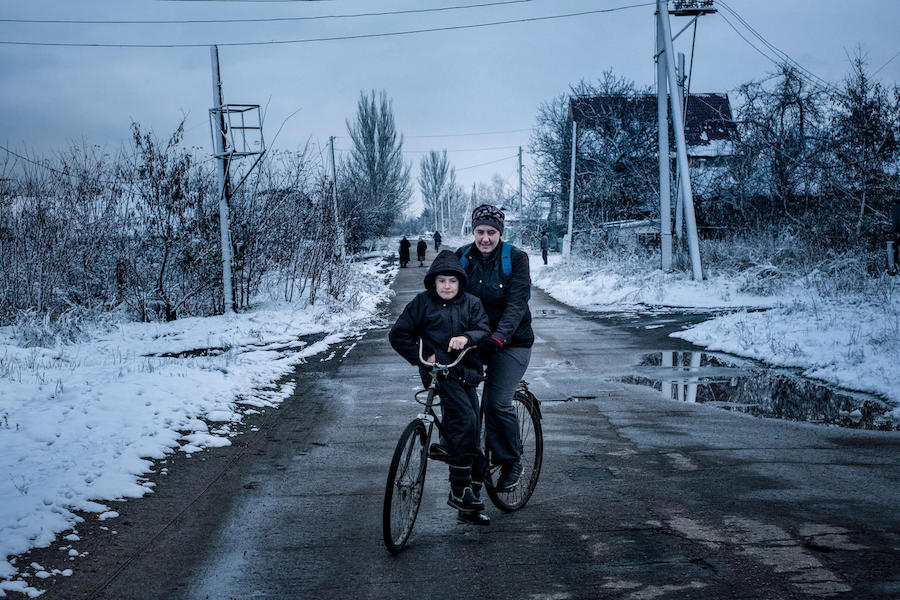"Misha, 9, and his mother live in the ""grey zone"" in Marinka, Donetsk Oblast, Ukraine, November 2017. Marinka sits on the contact line that divides government and non-government controlled areas in eastern Ukraine."