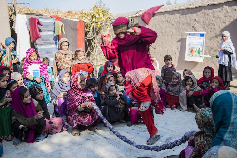 Children play games at a UNICEF-supported Child-Friendly Space in Afghanistan's Nangarhar Province, near the border with Pakistan.