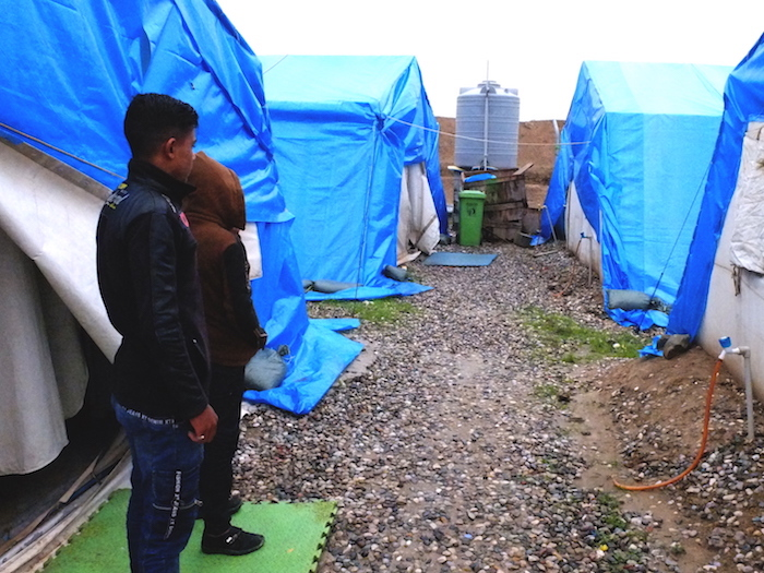 Aziz, 11, and Mahmoud, 17 (names changed), in front of their tent in Debaga camp.