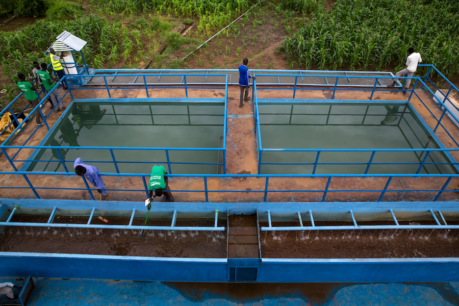 Employees work at the Bentiu water treatment plant in Bentiu, South Sudan, July 2017.