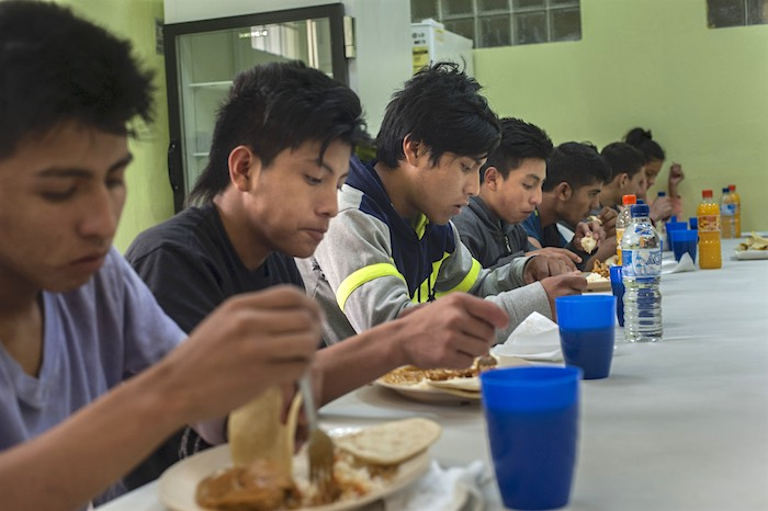 Eight migrant teens eat lunch in a Guatemalan shelter after deportation. They were detained in Mexico on July 4, 2016 while attempting to travel to the U.S.