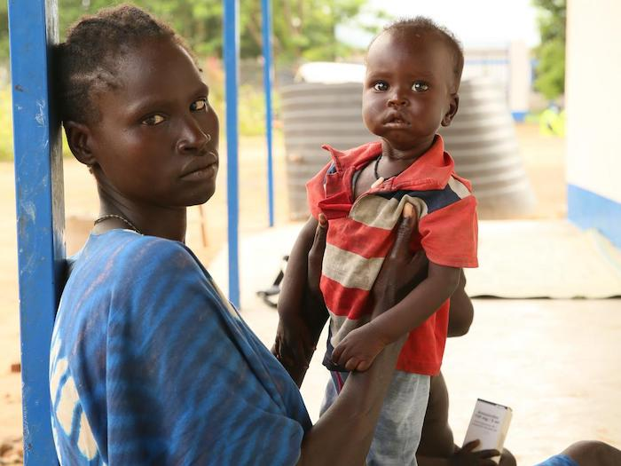 Bulo, photographed with his mother, recovered from severe acute malnutrition at a treatment center in rural South Sudan supported by UNICEF and partners.
