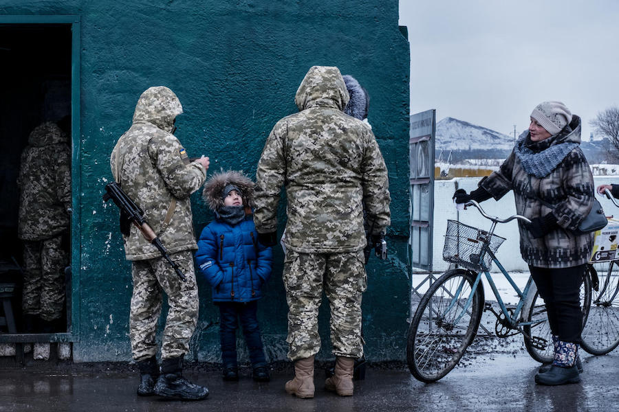 A child crossing a checkpoint overseen by the Ukrainian military in Donetsk Oblast, Ukraine, November 2017. Lines at the checkpoint can last an entire day for people trying to cross.