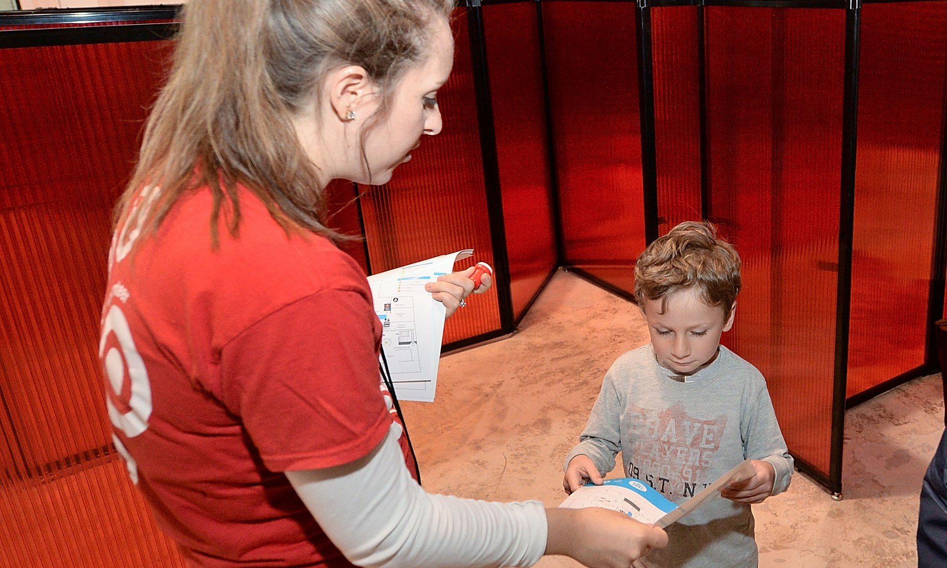 A Target volunteer helps a child at a UNICEF Kid Power Month event in Chicago.