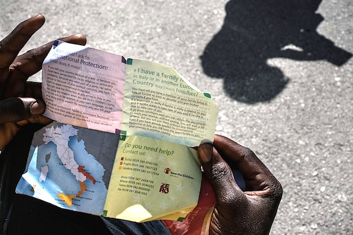 An instruction sheet for asylum applications for boys, mostly from Mali, Gambia, and other West African nations, at a government reception center that doubles as a lodging station for unaccompanied minors in Pozzallo, Sicily, Italy.