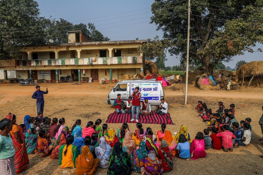 In the village of Madhwa in India's Jharkhand state, where 6 out of 10 girls are married before age 18, residents watch a play about the negative impact of child marriage.