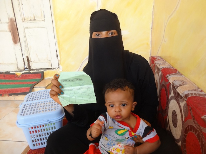 Arwein Ahmed, 26, holds the paper indicating she was vaccinated against tetanus by UNICEF-supported health workers when she was pregnant with her son, Abdulrahman, who was born healthy as a result.