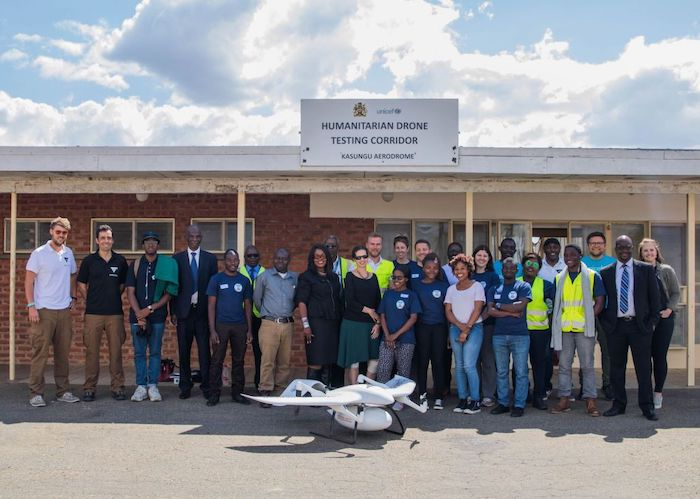 UNICEF Malawi staff and partners assemble to view bi-directional drone test flights at the Humanitarian Drone Testing Corridor in Kasungu, Malawi in 2019.