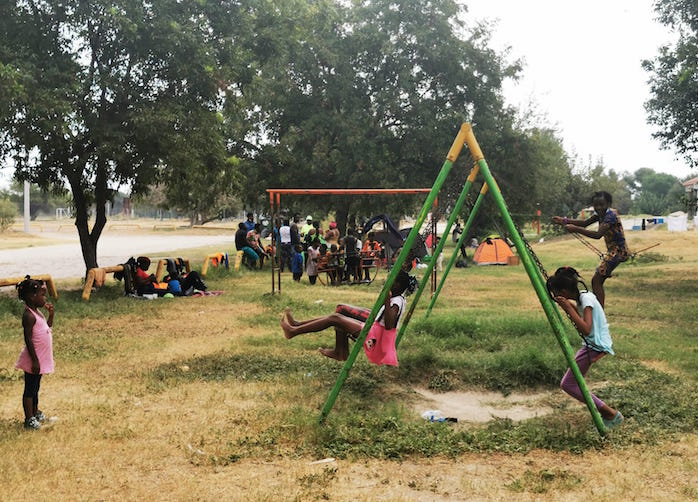 Children migrating with their families from Haiti play in Ciudad Acuña, Mexico in September 2021.