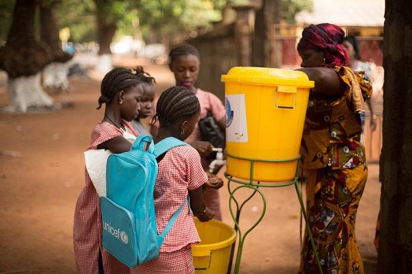 Children are washing their hands before entering their school as a hygiene measure to contain the Ebola outbreak. Thanks to these measures, none of the children in this school in Forecariah, Guinea got sick, during the height of the Ebola outbreak.
