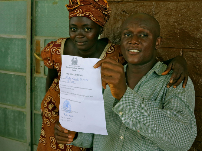 Alhassan holds up his discharge certificate. (c) UNICEF Sierra Leone/2014/Dunlop