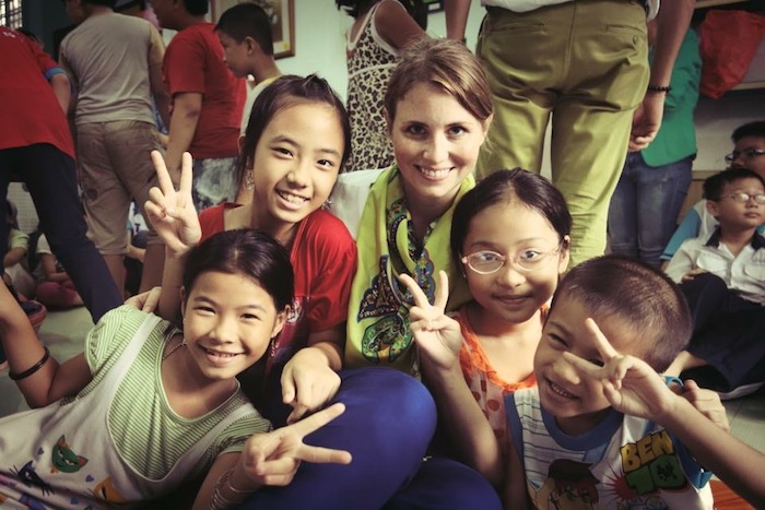 UNICEF Next Generation board member Emily Griset with schoolchildren in Ho Chi Minh City, Vietnam.