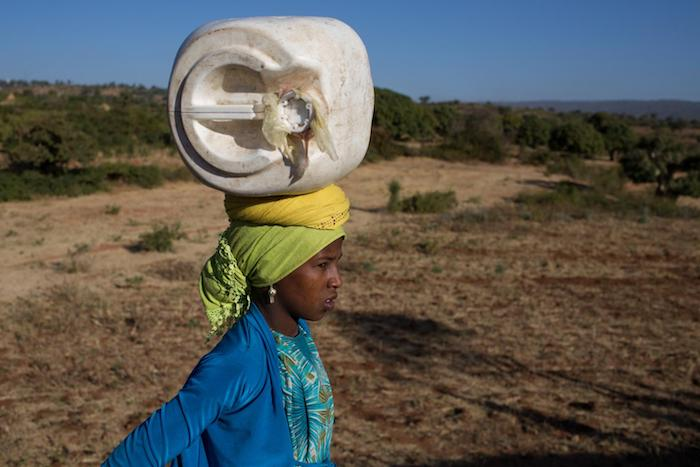 Seudi, 12,carries water back to her family home in a village outside Harar, Ethiopia in 2015.