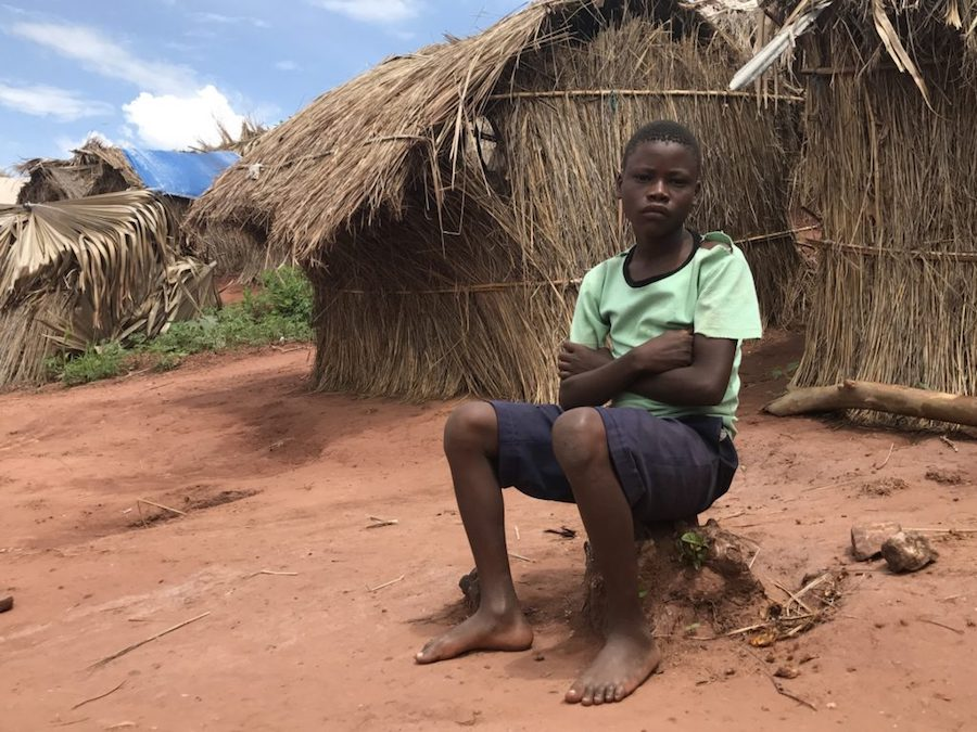 Gérome, 13, has been living with neighbors in the Katanika 2 camp in Tanganyika. His mother and grandmother were killed in an attack on their village. He doesn't know if his father is still alive.