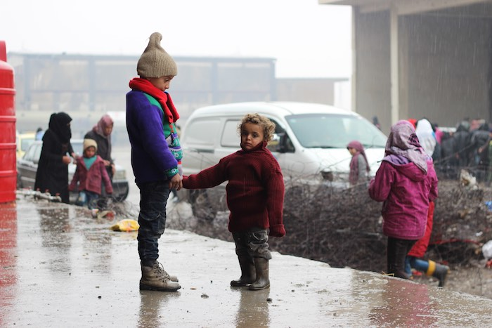 Children stand in the yard of a large warehouse in Jibreen, now used as a shelter for thousands of families who fled violence in east Aleppo. It is reported that some 31,500 people have been displaced from and within the area since 24 November.