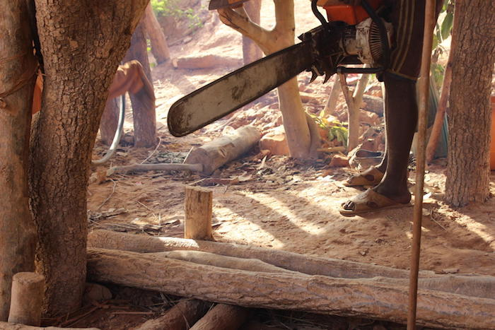 Daby, 14, operates a chainsaw at the Belema gold field in Mali, June 2017.