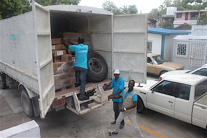 UNICEF loads supplies in Haiti to prepare for Hurricane Matthew emergency relief.