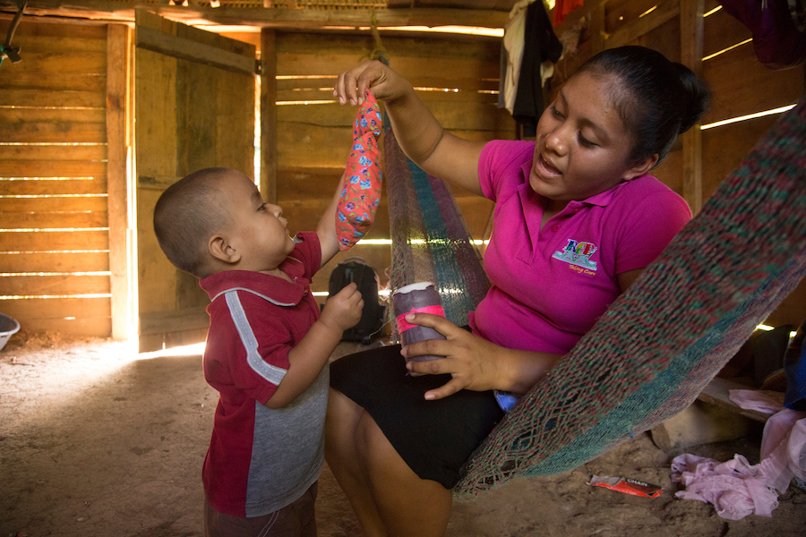 On 14 August 2016 in Belize, Abner Choc, 2, and Melisha, a facilitator from the UNICEF-supported Roving Caregivers Program (RCP), play during her visit to his home, in San Felipe Village in the Toledo region.